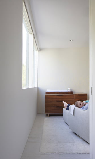 The owners' baby girl peeks out from her bright, new nursery.