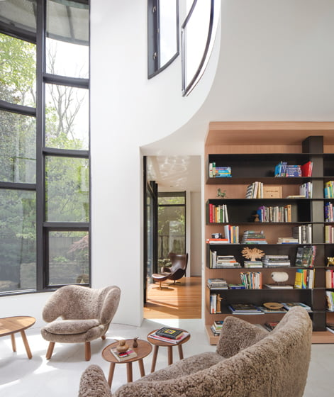 The former aviary—housed in a tower with the master bedroom above—has been converted into an airy sunroom.