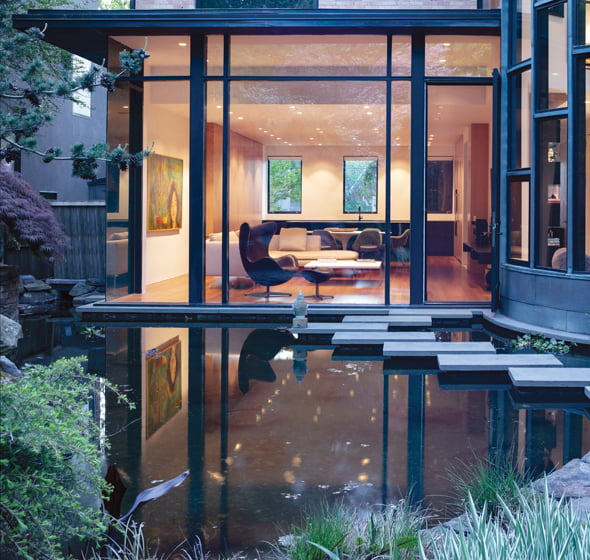 The kitchen and living room overlook a pond that architect David Jameson designed in the previous renovation.