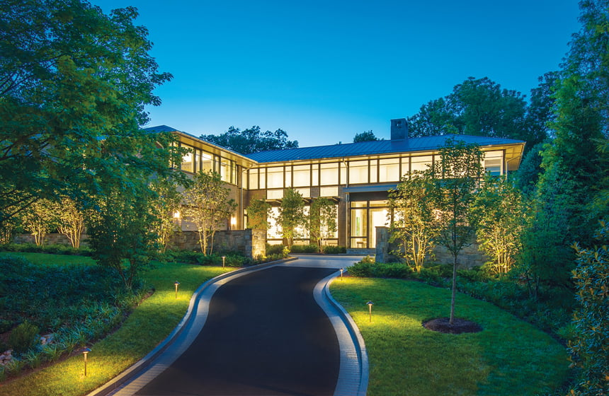 A light-filled, custom Bethesda home designed by Stephen Muse glows at night. © Maxwell MacKenzie