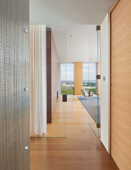 Clad in quarter-sawn white oak and wenge, the master bedroom bridges both sides of the penthouse. © Anice Hoachlander