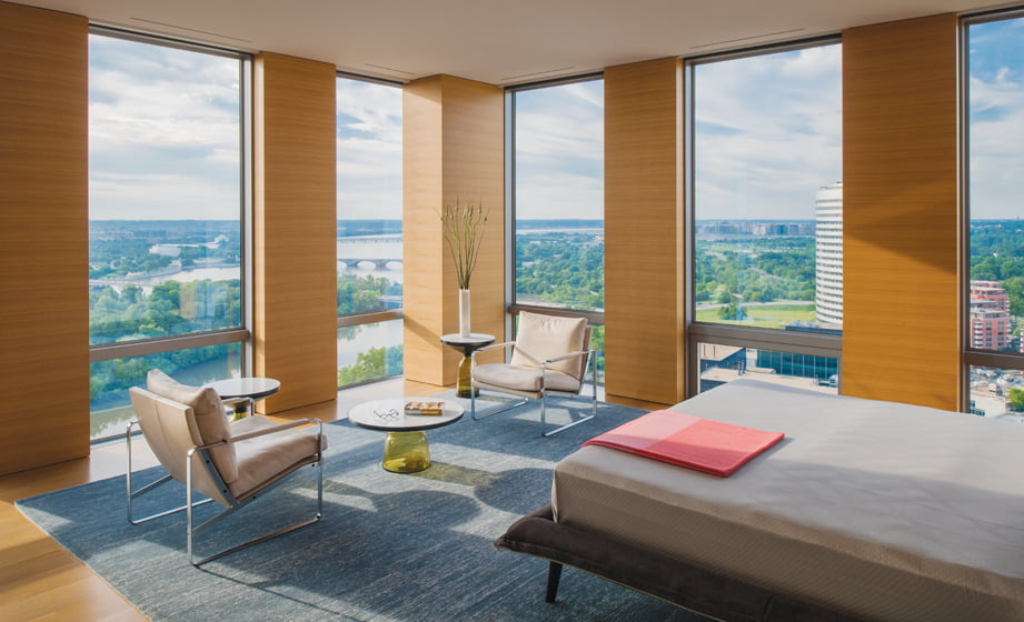 The master bedroom incorporates a sitting area for enjoying vistas  of the Potomac River. © Maxwell MacKenzie