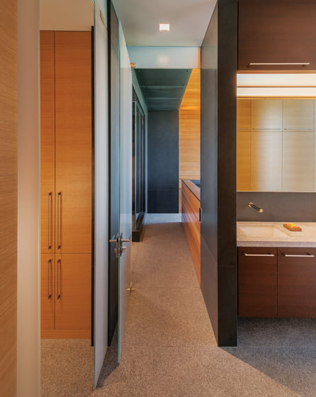 The sleek master bath is clad in cedar. © Maxwell MacKenzie