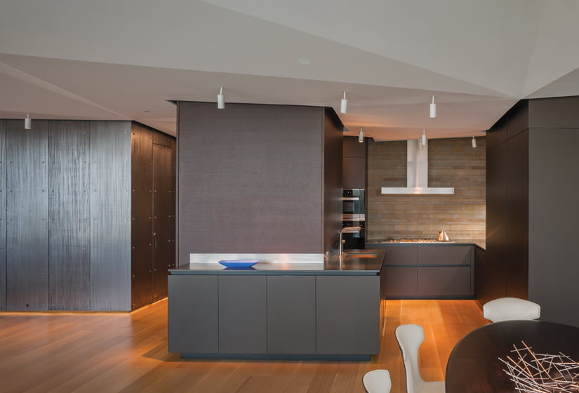 The kitchen features Gaggenau appliances and Boffi cabinets and walls finished in wenge. © Maxwell MacKenzie