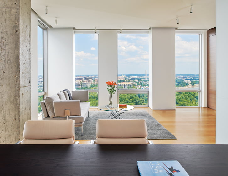 At one end of the room, a Walter Knoll sofa provides a perch for admiring the cityscape. © Anice Hoachlander