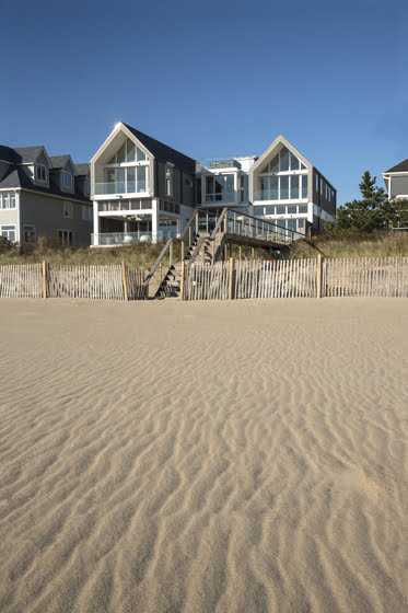 On the beach side, the home's southern wing juts out to screen the adjacent property.