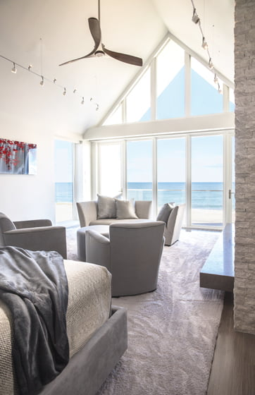The master suite boasts custom, automated shades on all the bedroom windows.