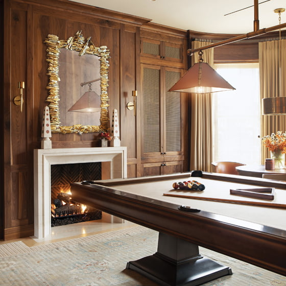 The second-floor billiard room functions as both library and game room.