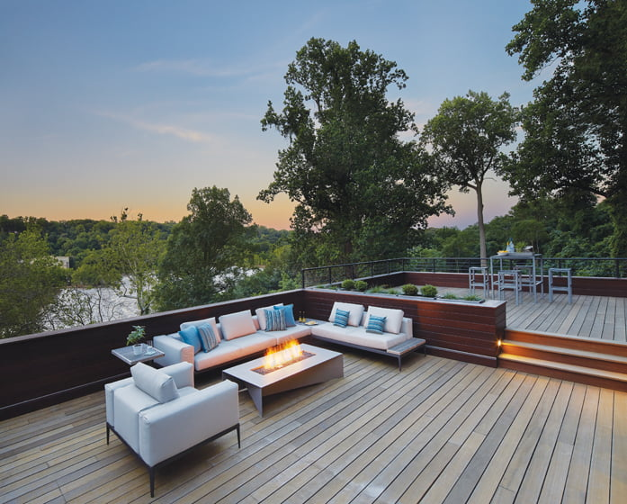 On the ipe roof deck, Gloster seating around an Equinox Solstice fire table beckons. Dramatic views of the Potomac lie just beyond.