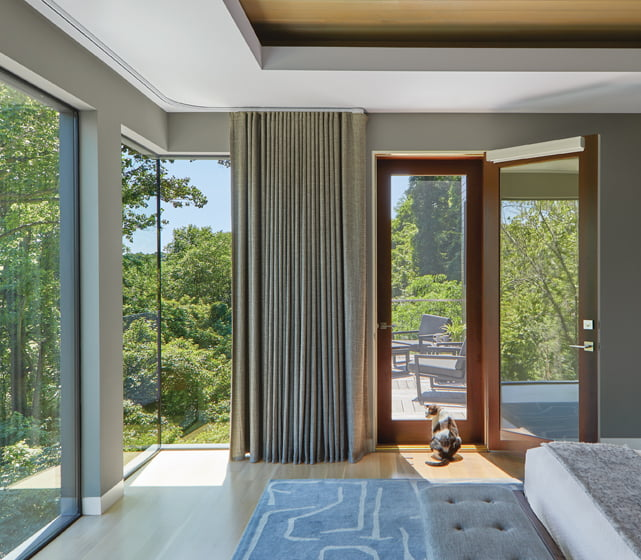 Glass corners take in the views, as does a private deck off the master bedroom.