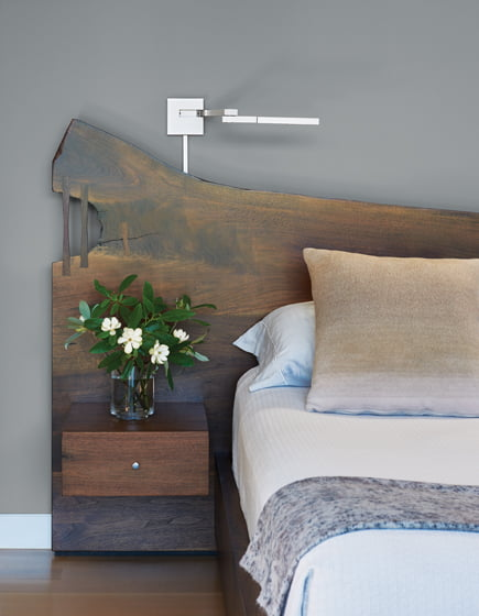 A live-edge walnut bedstead by Withers & Grain features built-in nightstands. Bedside lamps are by Marset.