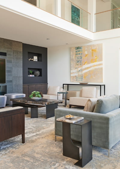 In the adjoining River Room, Holly Hunt tables flank a 115-inch sofa upholstered in Donghia fabric.