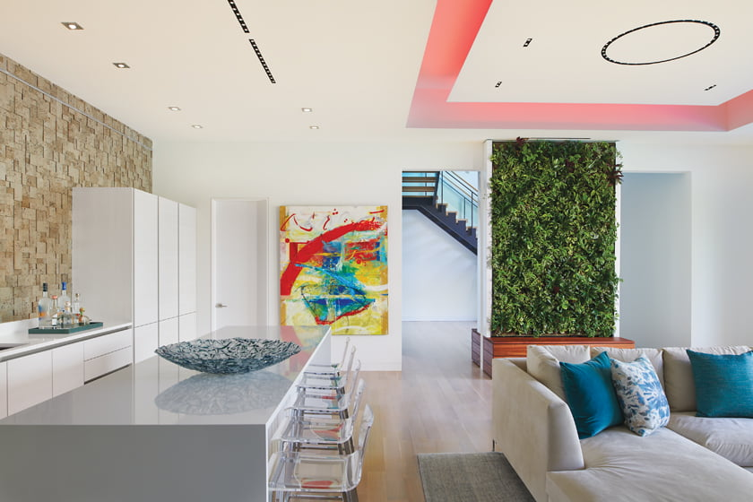 A dropped  ceiling with color-control LED lights lends a playful vibe to the rec room.