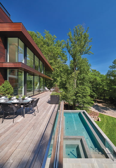 Mahogany architectural overhangs protect interiors from strong sun.