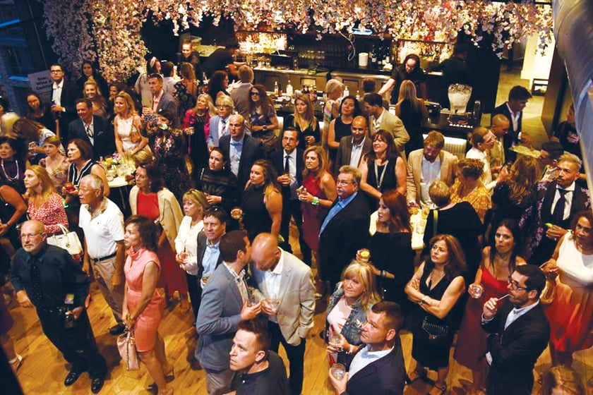 Attendees mingled over cocktails and entertainment.