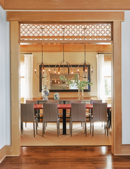 The dining room off the entrance hall holds Roche Bobois furniture and pendants from Hubbardton Forge.