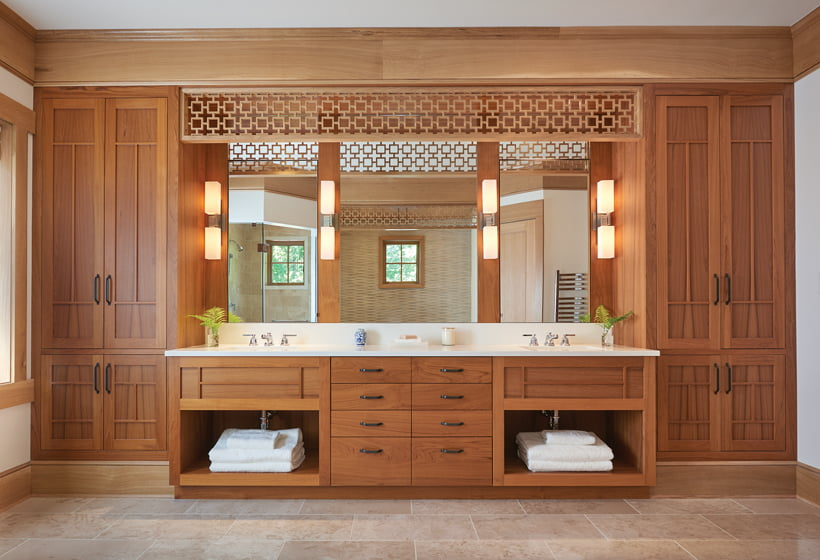 In the master bathroom, the teak cabinets and vanity were custom-designed by Barnes Vanze.