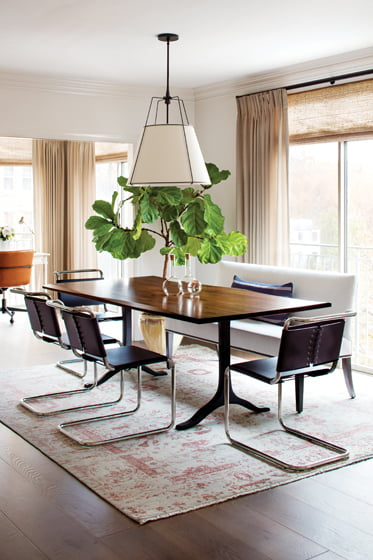 In the dining room, a hand-knotted Stark rug from India grounds the live-edge Arhaus table.