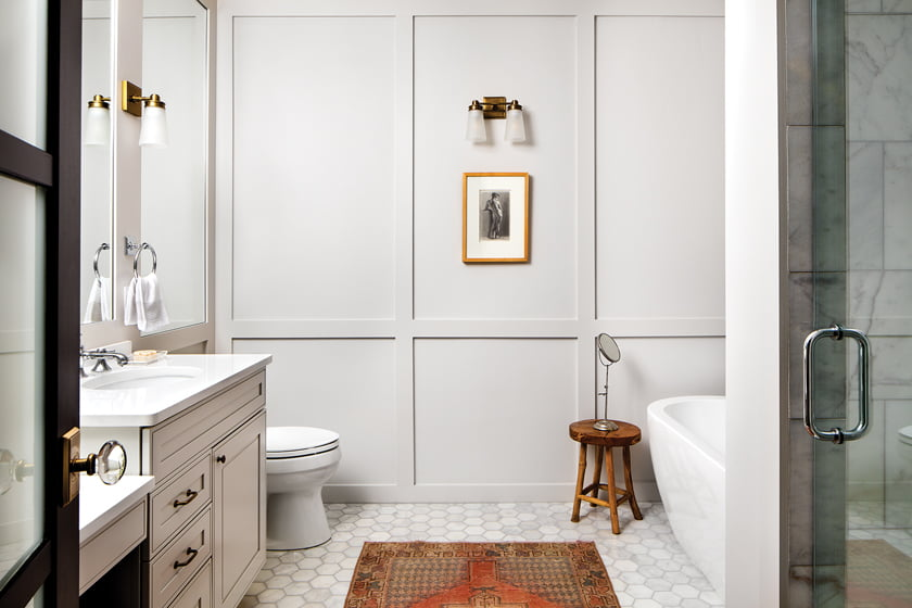 The reworked master bath features pale-gray millwork and a floor of hexagonal marble tile.