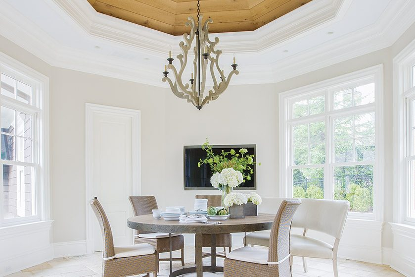 Architect Mark Sullenberger and designer Kristin Peake collaborated on a McLean project, where the breakfast  room (above) was enhanced by salvaged wood in the domed ceiling. JANUS et Cie chairs and a wooden  Currey & Company chandelier complete the look.   Photo: Geoffrey Hodgdon