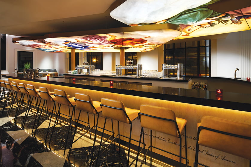 In the sleek Living Room bar, a floating panel replicates artwork from the Capitol dome.