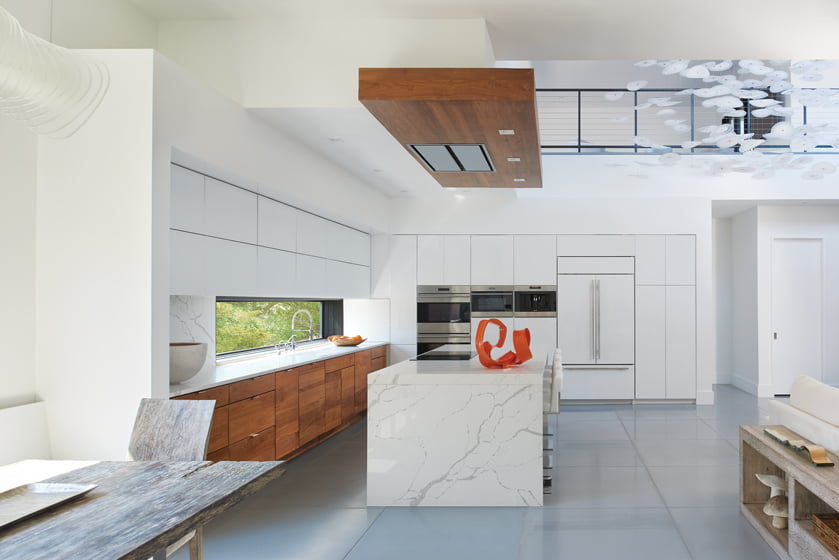 Walnut accents provide contrast in the white kitchen. © Anice Hoachlander