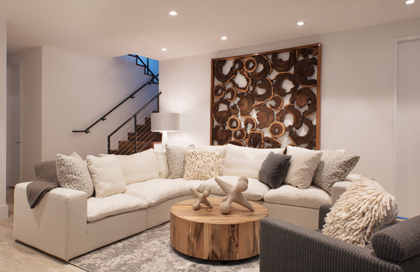 The kids' hangout combines a white sectional with rustic wood accents. © Geoffrey Hodgdon