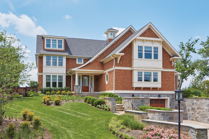 The home's façade has been enhanced with bay windows, sloped rooflines, gables and a cupola.