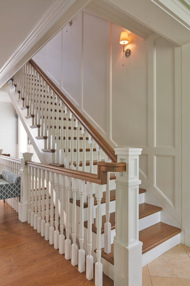 The closed-off staircase was replaced by an airy, open one bordered by millwork.