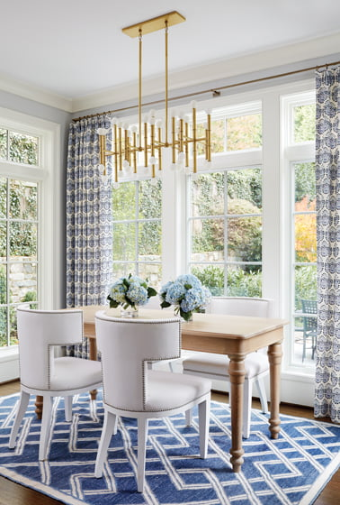 A Robert Abbey chandelier brings spatial definition to the breakfast nook.