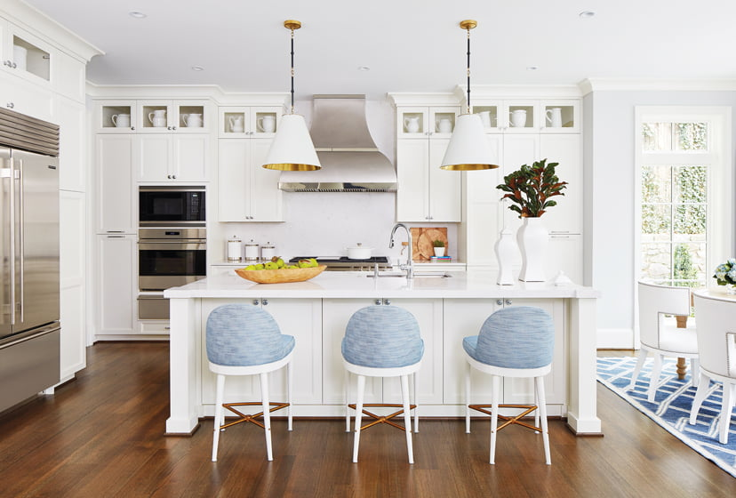 Barstools by Hickory Chair add a touch of color to the white kitchen.