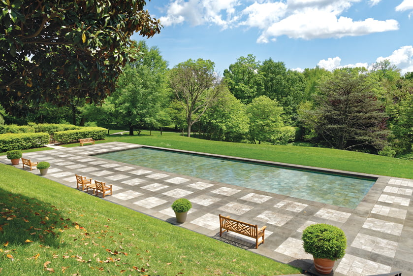 The reflecting pool invites visitors to sit on benches that take in the view.