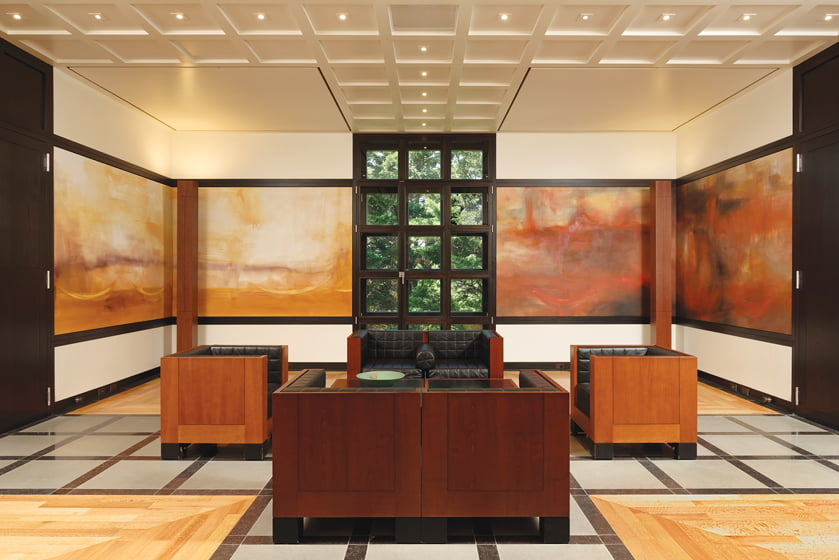 The gentlemen's sitting room is adorned with paintings by Christa Näher depicting the elements.