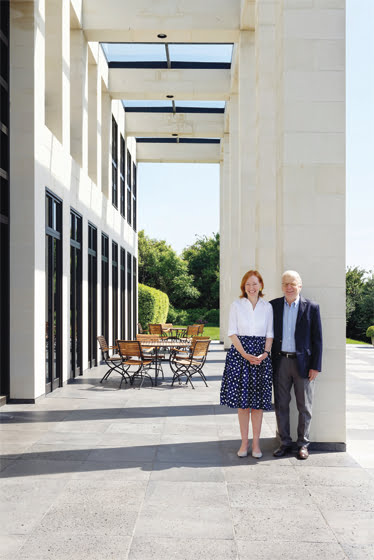 German Ambassador to the U. S. Emily Haber and husband Hansjörg Haber stand on the back terrace.