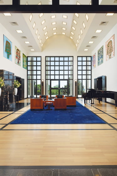 The reception hall reveals a square motif in its window grid and barrel ceiling.
