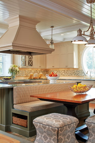 A banquette is integrated with the kitchen island.