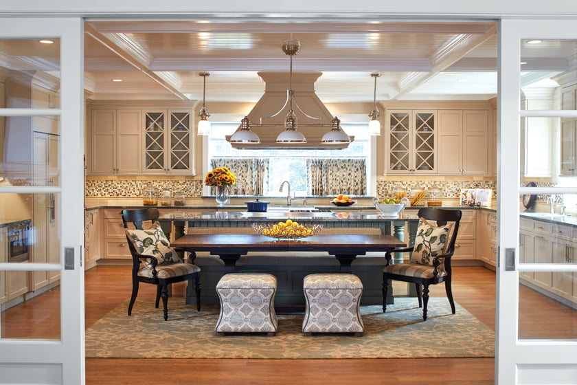 The kitchen combines custom cabinetry, granite counters and a glass backsplash.