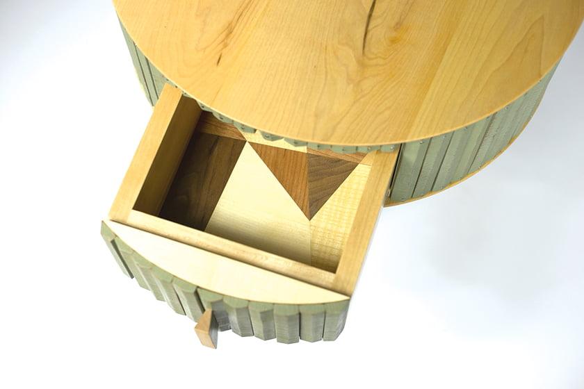 A drawer detail reveals cherry, walnut, maple and oak veneers. © Chris Thomas