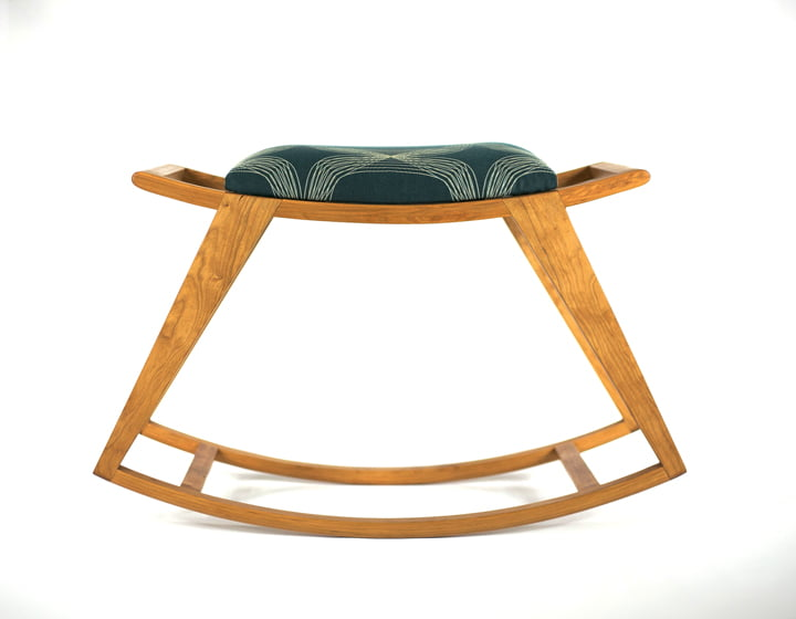 Rocking Stool is made of cherry with an upholstered seat. © Chris Thomas