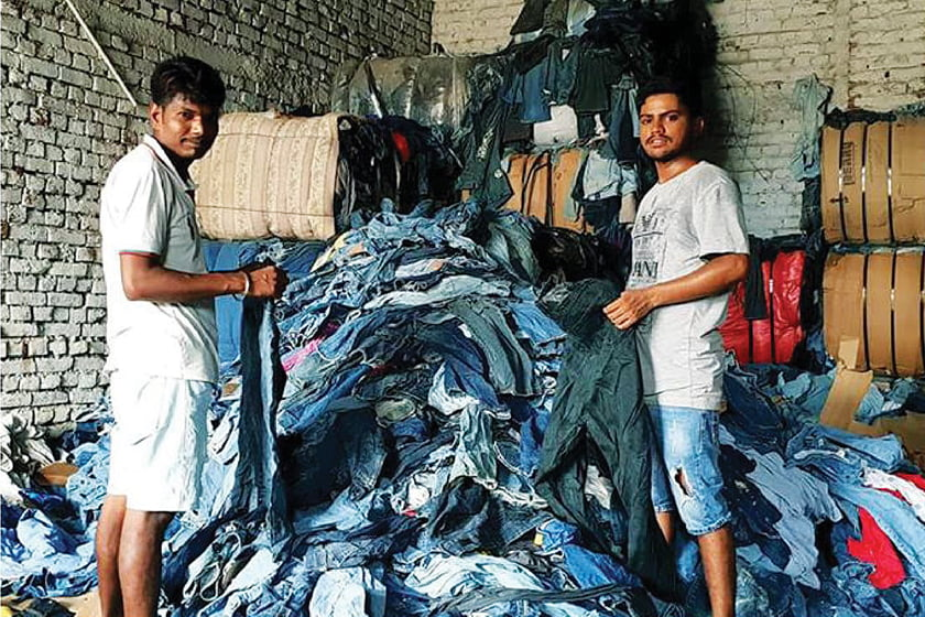 Workers begin the process by sorting through jeans.