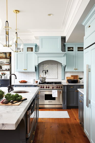 Marble-look quartz countertops complement upper cabinets in Farrow & Ball's Teresa's Green.