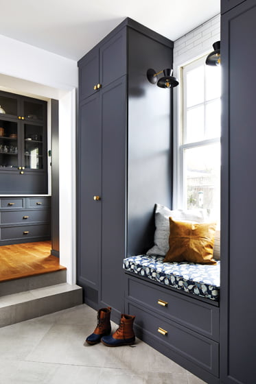 The adjoining mudroom features built-ins and a window seat.