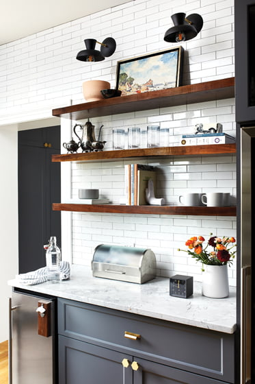 Open shelving imparts airiness to the pantry.