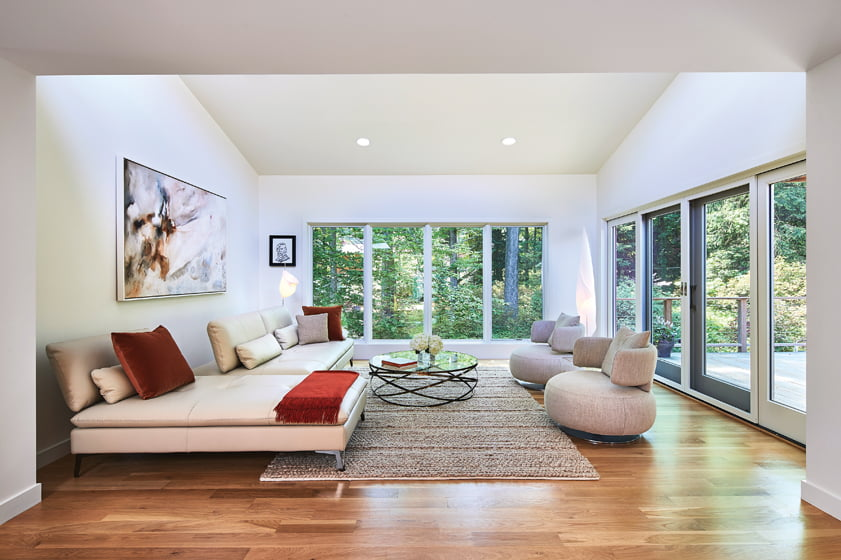 The second story of the addition boasts clean-lined furnishings and four-inch-wide white-oak flooring.