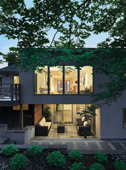 The two-story addition emphasizes a connection to the outdoors.