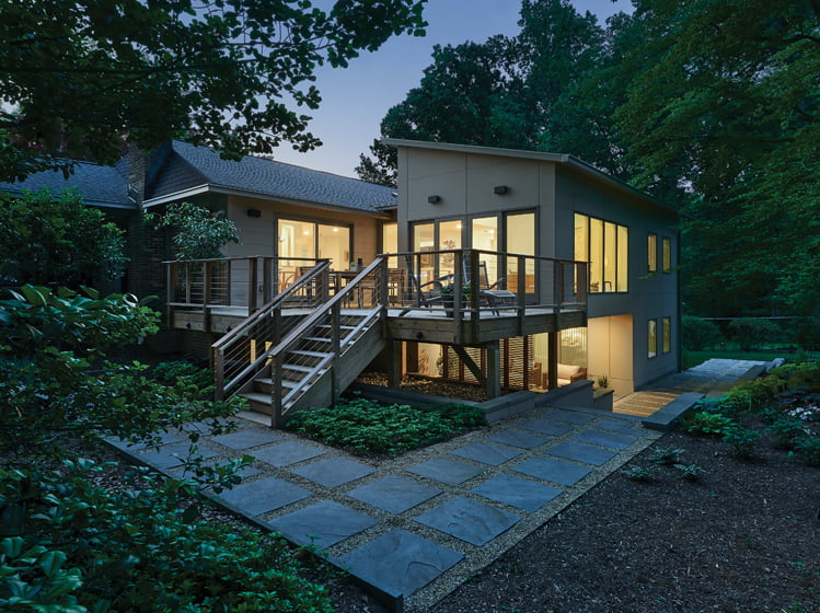 """The two-story addition is linked to the original structure by a spacious deck and connective """"tether."""""""