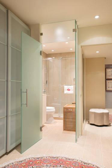Frosted-glass doors allow privacy without compromising on light.