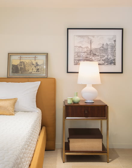 A comfortable bedroom includes an upholstered bedstead.