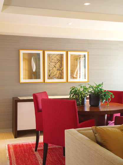 Santalla enhanced the space with silk wall covering in a complementary hue that accentuates the ceiling design.