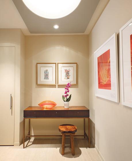 The vestibule features a niche for a Mitchell Gold + Bob Williams console.